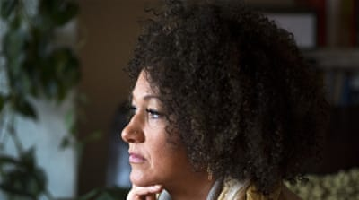 The parents of Dolezal, right, said their daughter is white with a trace of Native American heritage [AP]