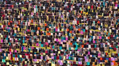 Thinking of You features some 5,000 dresses hanging on clotheslines in the city stadium of Pristina. [Jetmir Idrizi/Al Jazeera]