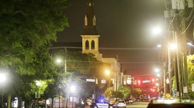 The Emanuel AME Church is visible as police close off a section of Calhoun Street following a shooting in Charleston, South Carolina [AP]