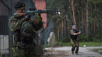 The conflict in eastern Ukraine has claimed more than 6,500 lives and destroyed much of the region [AP]