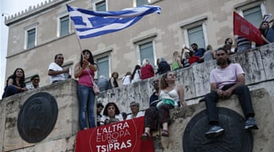 An anti-austerity protester at a rally in front of the parliament in Athens, Greece [AP]