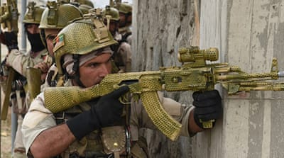 Afghan Crisis Response Unit personnel take up positions during a training exercise in Kabul [AFP]