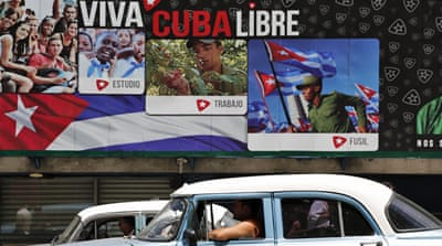 Capitalism meets communism head on in Cuba