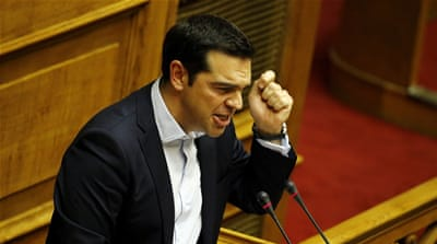 Tsipras is applauded by Cabinet members after his speech, during a debate on the referendum at the Greek Parliament in Athens [EPA]