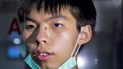 Joshua Wong, 18, faces trial over his role in protests that sparked months-long pro-democracy street occupations [Vincent Yu/AP]