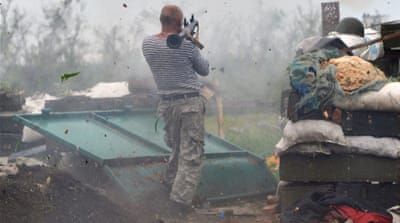 The conflict between the Ukrainian army and rebel forces has killed more than 6,400 people [File: AFP/Getty]