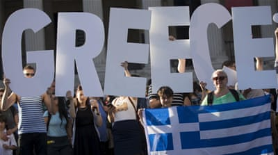 Demonstrators gather to protest against the European Central Bank's handling of Greece's debt repayments [Reuters]