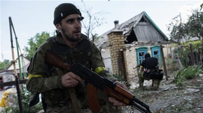 Ukrainian troops have been battling pro-Russia rebels in the country's east since last year [AP]