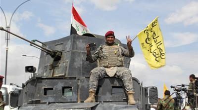 Iraqi forces, including soldiers, police officers, Shia militias and Sunni tribes, celebrate after regaining full control of Tikrit [Getty]