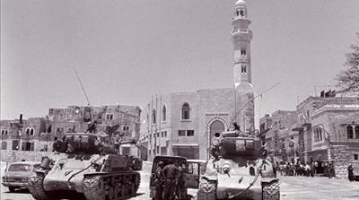 Two US-made Israeli Super-Sherman tanks patrolling in East Jerusalem, June,1967 [AFP]