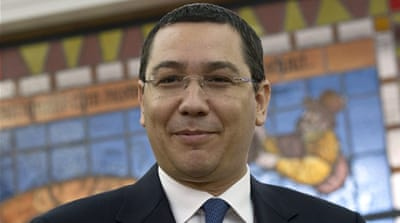 Ponta's centre-left government faces a vote of no-confidence on Friday [AP]