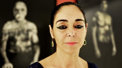 Shirin Neshat poses at the Dirimart Gallery during the presentation of 'The Book of Kings' series in Istanbul in 2013 [Getty]
