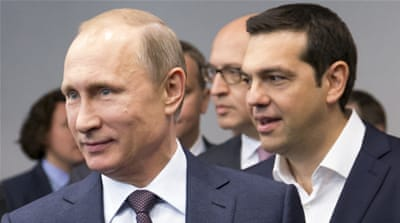 Putin and Tsipras arrive for their talks at an investment forum in St Petersburg, Russia [AP]