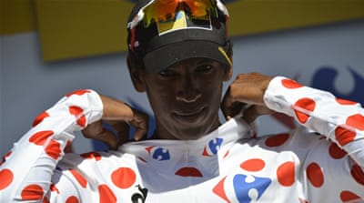 Eritrean rider Daniel Teklehaimanot became the first black African to wear a leader's jersey at a grand tour [AFP]