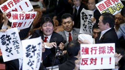 Many politicians and protesters in Japan have opposed the security bills [Reuters]
