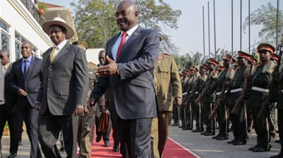 President Museveni, left, was chosen by regional leaders earlier this month to mediate between two sides [AP]