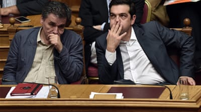 Greeks have been expressing outrage over an austerity bill that parliament passed on Thursday [Emilio Morenatti/AP]