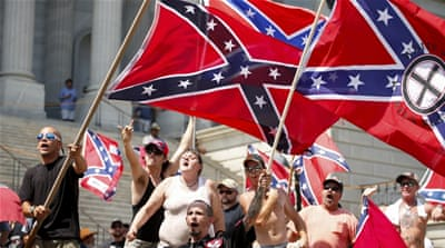 About 100 KKK members and their supporters were met by more than 400 counter protesters at the rally [Reuters]