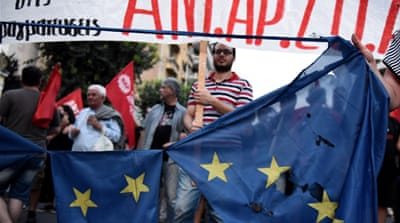 Demonstrators destroy a European flag during a rally by supporters of the 'no' vote in the Greek referendum [AP]