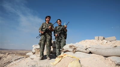 YPG women fighters in a check point at the outskirts of the destroyed Syrian town of Kobane [Getty]