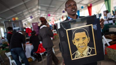 Kenyans get ready for US President Barack Obama's visit [AP]