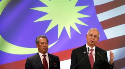 Prime Minister Najib Razak, right, dismissed Muhyiddin Yassin, left, on Tuesday [Reuters]