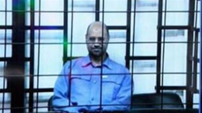 Saif al-Islam had appeared by video link in sessions at the start of trial [EPA]