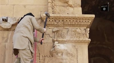 ISIL has released video of their fighters destroying artefacts in Iraq and Syria