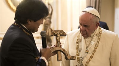 Morales hugged the pope as he descended from the Boliviana de Aviacion plane [Reuters]
