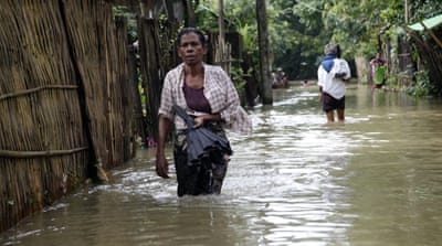"Rescue efforts by authorities and local aid groups were under way but they are ""struggling to access flood-hit areas"" [EPA]"