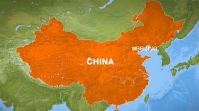 China officer gets suspended death sentence for graft