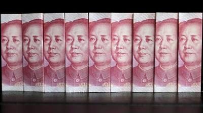 As China grapples with domestic economic woes, it will inevitably have to also re-evaluate its massive international spending spree, writes Heydarian [Reuters]