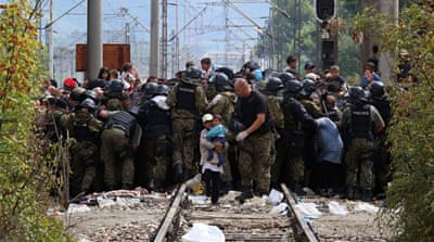 Between hope and despair: Refugees cross into Macedonia