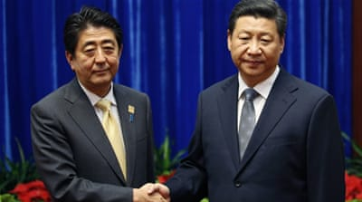 Relations have improved recently after the Japanese prime minister and the Chinese president met at multilateral gatherings [AP]