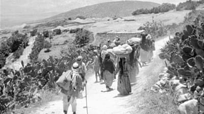 Palestinian refugees returning to their village after the 1948 Arab-Israeli war upon the proclamation of the Israeli State [AFP]