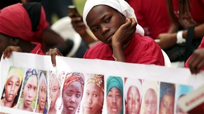Protesters in Nigeria and abroad have urged the government to do more to get the girls freed [Reuters]