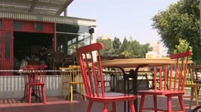 The owner of the restaurant said he did not know there was a grave under the cafe [Al Jazeera]