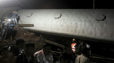 The two trains travelling in opposite directions derailed within minutes of each other [Reuters]