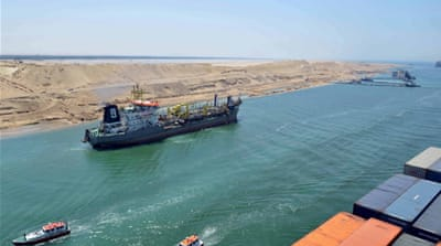 The first cargo ships passed through Egypt's New Suez Canal last week in a test-run before it opened on Thursday [Reuters]