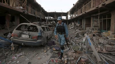 Cars parked on roads in the vicinity of the blast were damaged for at least 100 metres, a witness said [AFP]