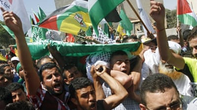 Palestinians bury father of baby burned to death