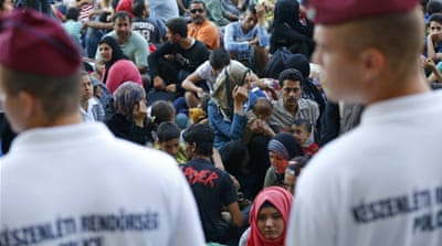 Hundreds of refugees stranded at the station have bought tickets to take the trains to Austria and Germany [Reuters]