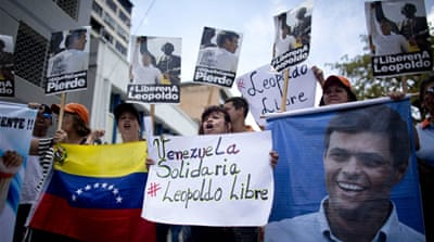 Supporters of Leopoldo Lopez gathered outside the courthouse in Caracas during the trial [Carlos Garcia Rawlins/Reuters]