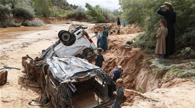 The Hildale women and children were returning from a park when they stopped at a crossing and got out to watch the raging waters [AP]