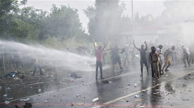 Hungary fires tear gas, water cannon at refugees