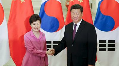 Xi Jinping shakes hands with South Korean President Park Geun-hye in Beijing, China [REUTERS]