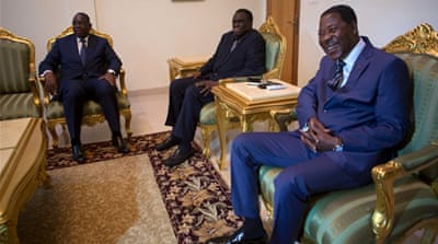 Senegal President Macky Sall and Benin President Boni Yayi with Burkina Faso transitional president, Kafando, after the talks [Reuters]