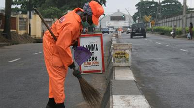 A day in the life of... a Lagos street sweeper