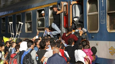 Refugees in Hungary want to get on trains to go to either Austria or Germany [Reuters]
