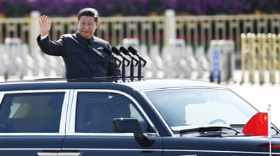 Critics say the latest measures are a new way for President Xi to target his political opponents [Damir Sagoli/Reuters]